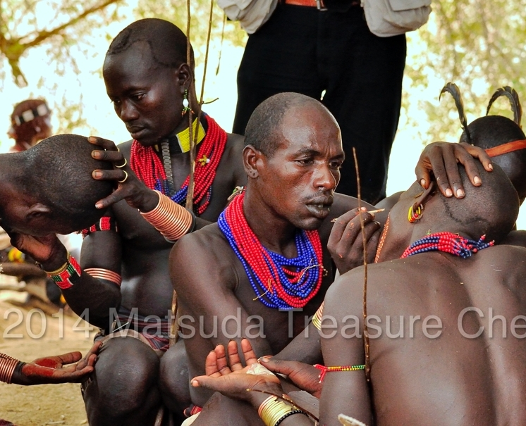 The Hamar men is busy doing face painting for the Bull jumping ceremony