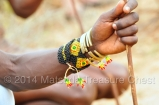 Close up look of a multi colored seed bead bracelets combined with metal bracelets