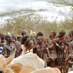 Friends and family gather around to celebrate the success of the Bull Jumping ceremony