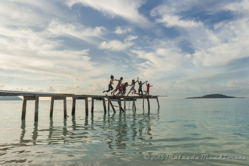 Island children with their routine jump at the jetty