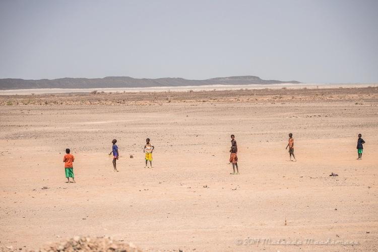 Children playing soccer under the heat. Estimated temperature was around 34 degree