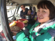 Alma and Oyunna cooking for our lunch in the van